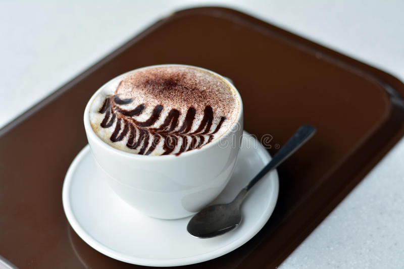 Cup Of Hot Cappuccino On The Table royalty free stock photography