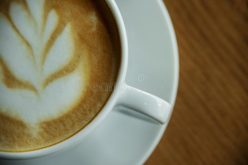 Cup of hot cappucino. On the wooden table. Early morning breakfast stock photo