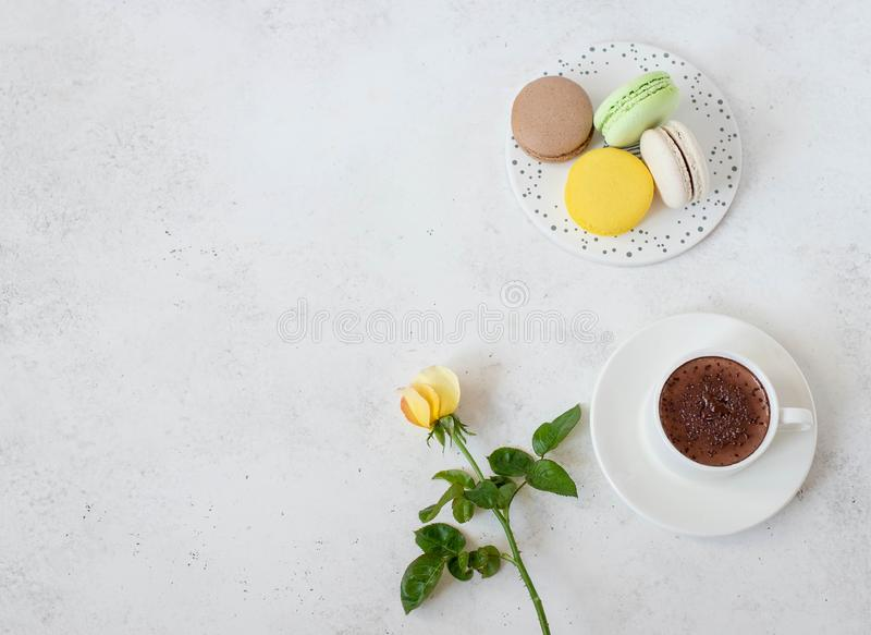 Cup of hot chocolate with macarons flowers on a white background stock images