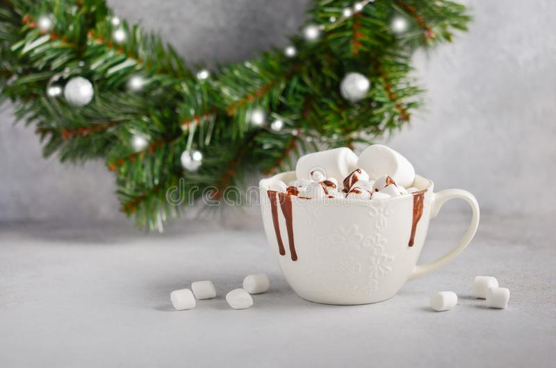 Cup of hot chocolate with marshmallows on a gray concrete background. Christmas concept. stock photos