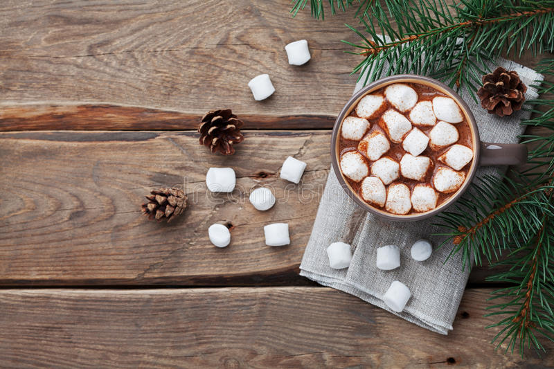 Cup of hot chocolate on wooden rustic table from above. Delicious winter drink. Flat lay. stock photos