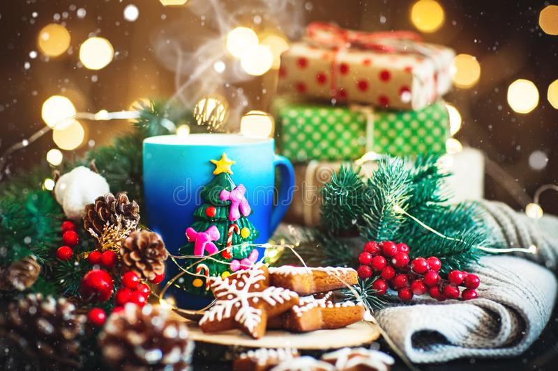 A Cup of hot cocoa in a Christmas mug on the background of Christmas garlands. Merry Christmas and happy New year. Selective focus. Horizontal royalty free stock photos