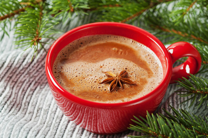 Cup of hot cocoa or hot chocolate on knitted background with fir tree stock photos