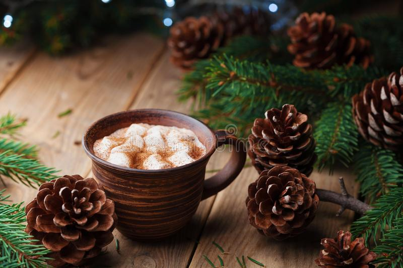 Cup of hot cocoa with marshmallows on rustic wooden table. Cozy christmas still life. Winter beverage. stock photography