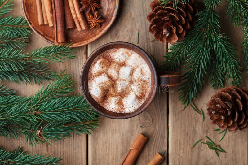 Cup of hot cocoa with marshmallows on rustic wooden table top view. Cozy winter still life. royalty free stock images