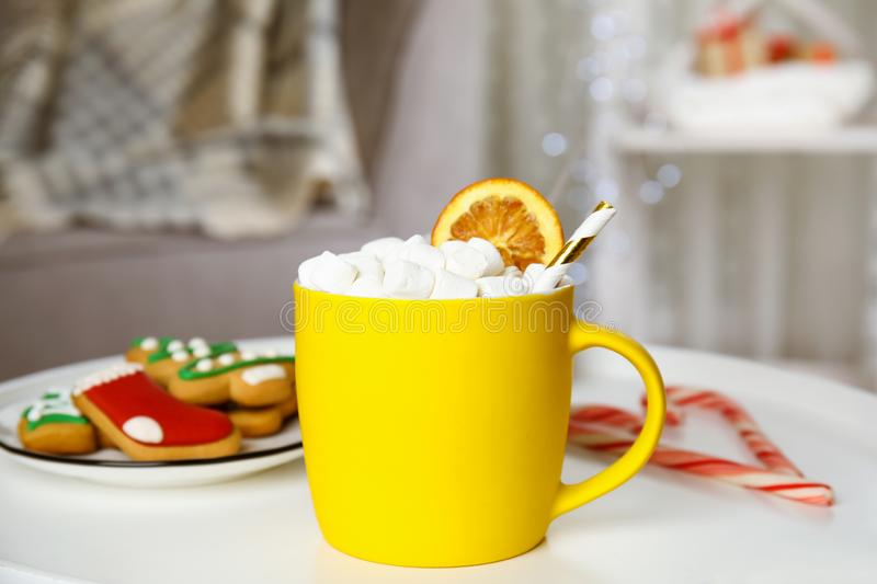 Cup of hot cocoa with marshmallows on white table indoors. Winter drink stock photography