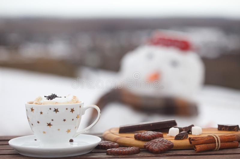 Cup of hot coffCup of hot coffe or espresso with cream, cookies and chocolate stock photos