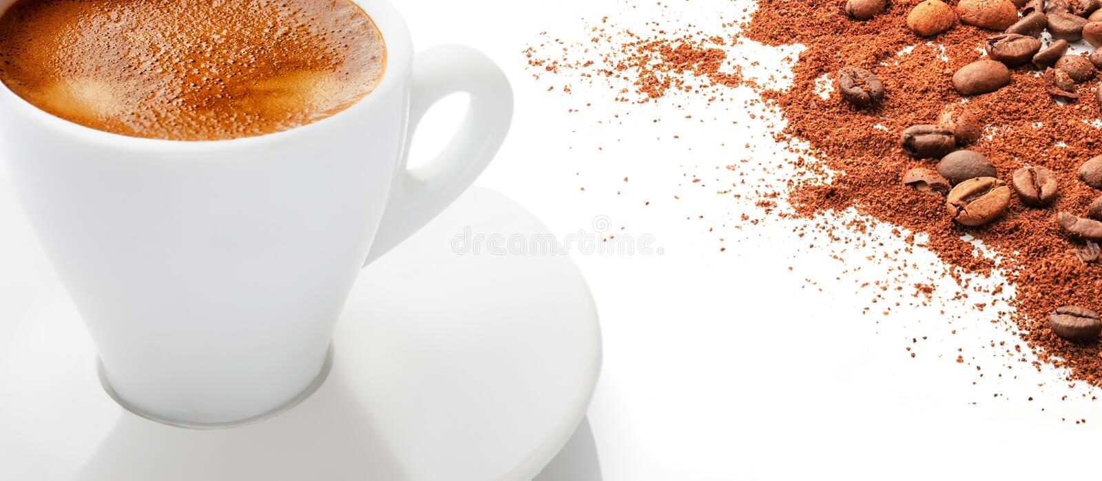 A cup of hot coffee with coffee beans on a white background stock photos