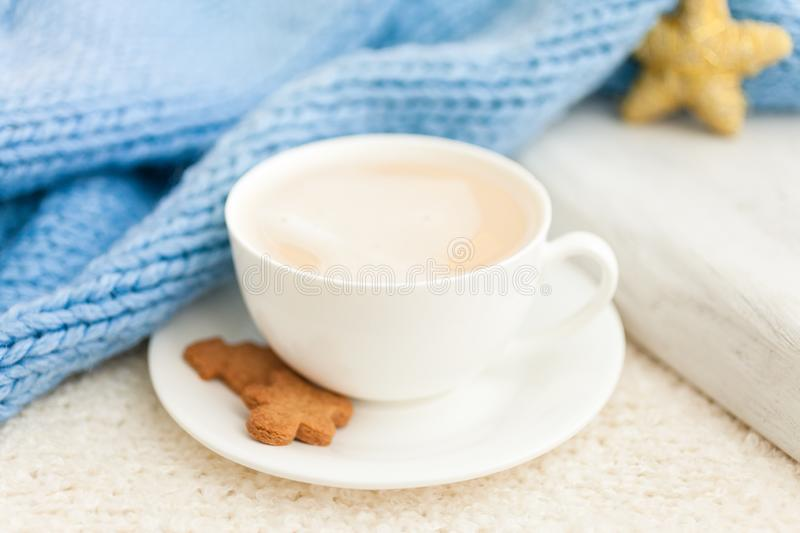 Cup of hot coffee with christmas gingerbread cookie man. Traditional holiday sweet. Winter background royalty free stock photos