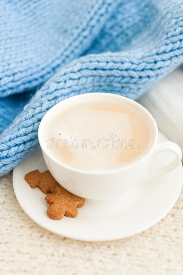 Cup of hot coffee with christmas gingerbread cookie man. Traditional holiday sweet. Winter background stock photo