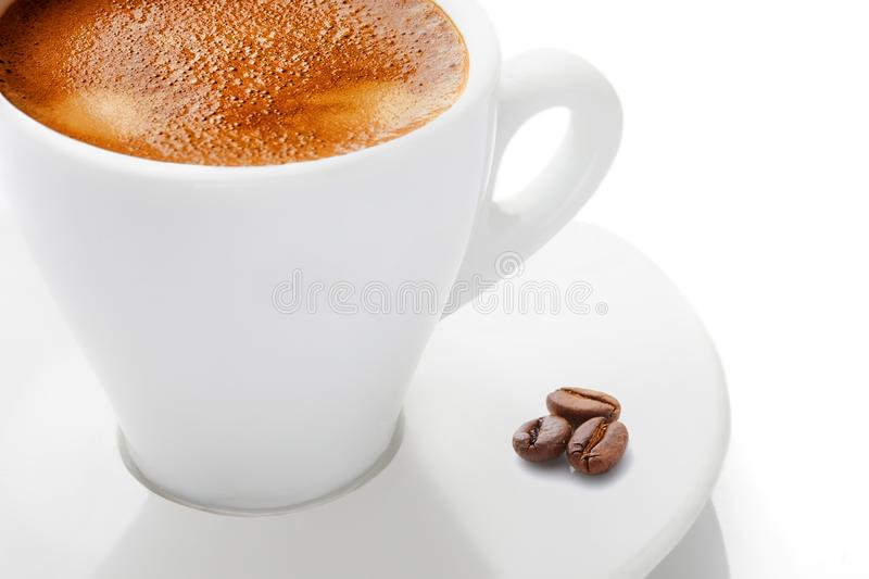 A cup of hot coffee with foam on a white background royalty free stock photo