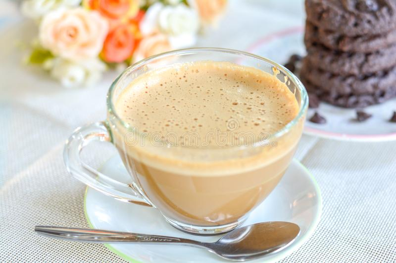 A cup of hot coffee served with dark chocolate cookies in morning. Aroma, bittle, cafe, restaurant, drink, beverage, fresh, breakfast stock photo