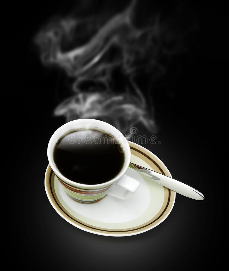 Cup of hot coffee with steam. On dark background stock photos
