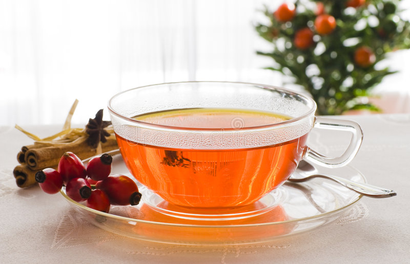 Cup of hot tea. Cup of tea with wild rose - herbal medicine stock photography