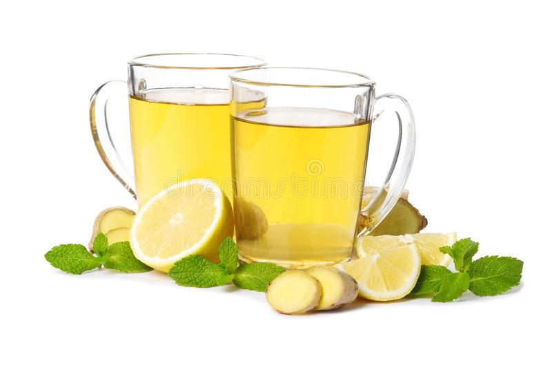 Cup of hot tea with ginger, lemon and mint isolated royalty free stock photography