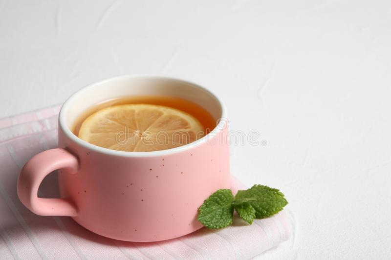 Cup with hot tea and lemon on white background. Space for text stock photos