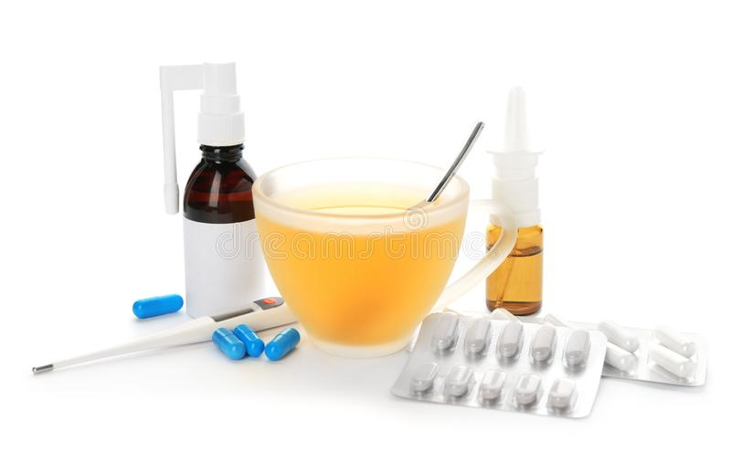 Cup with hot tea, pills and drugs for cold stock photography