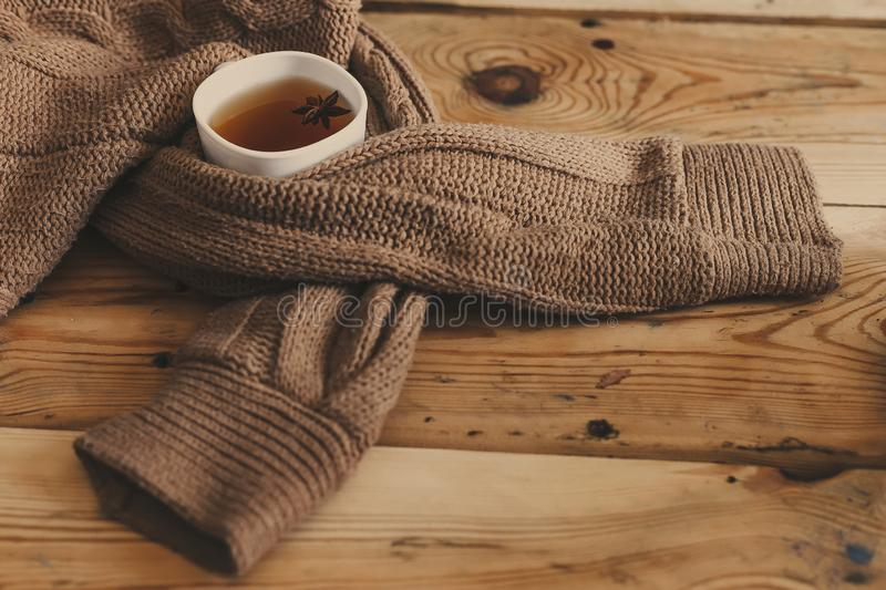 Cup of hot tea on wooden table. Cold autumn or winter days. A cup of hot tea on wooden table. Cold autumn or winter days. Warming herbal drink. Copy space royalty free stock photos