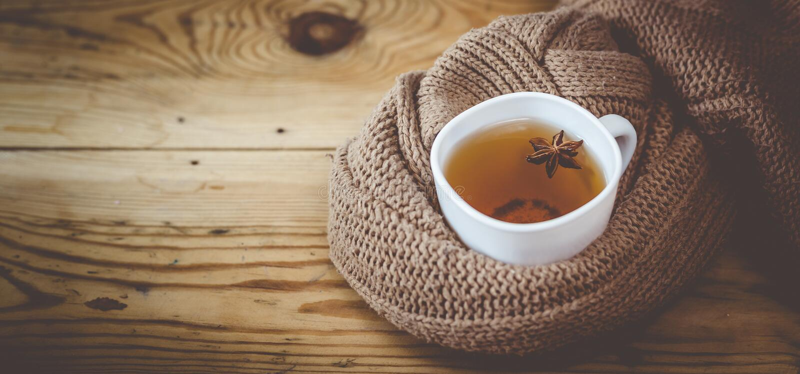 Cup of hot tea on wooden table. Cold autumn or winter days. A cup of hot tea on wooden table. Cold autumn or winter days. Warming herbal drink. Copy space royalty free stock photography