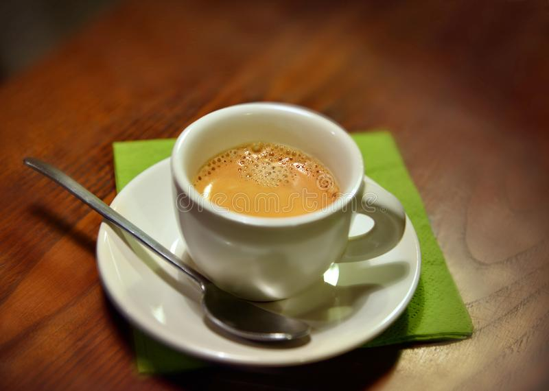 Cup of italian espresso coffe on a wood table close up view from above royalty free stock photo