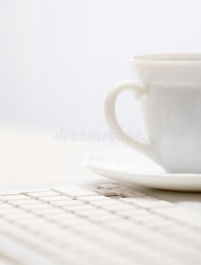 Download Cup On Keypad Stock Photography - Image: 20976192