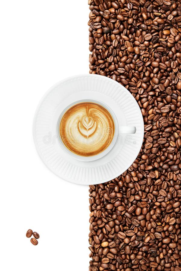 Cup of a Late , 3 isolated coffee beans in the left bottom corner, cup handle tilted right stock photography