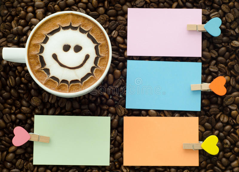 A cup of latte art. Coffee and clip note royalty free stock images