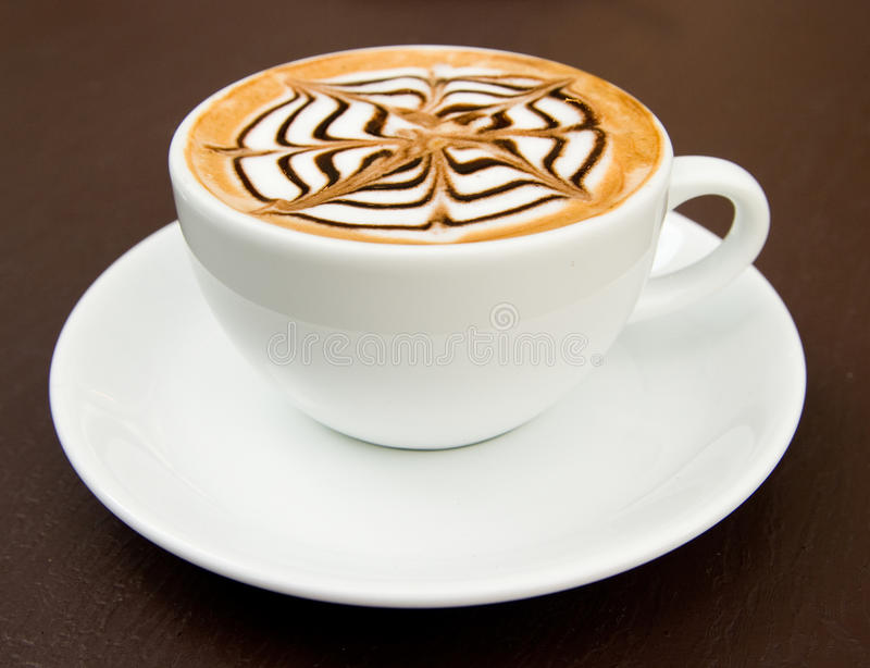 A cup of latte-art hot coffee stock photo