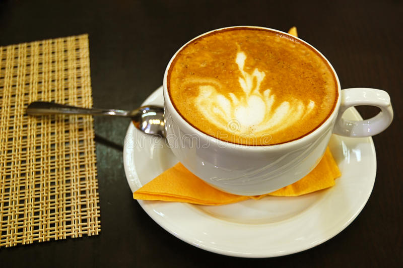 Cup of latte with spoon stock photography