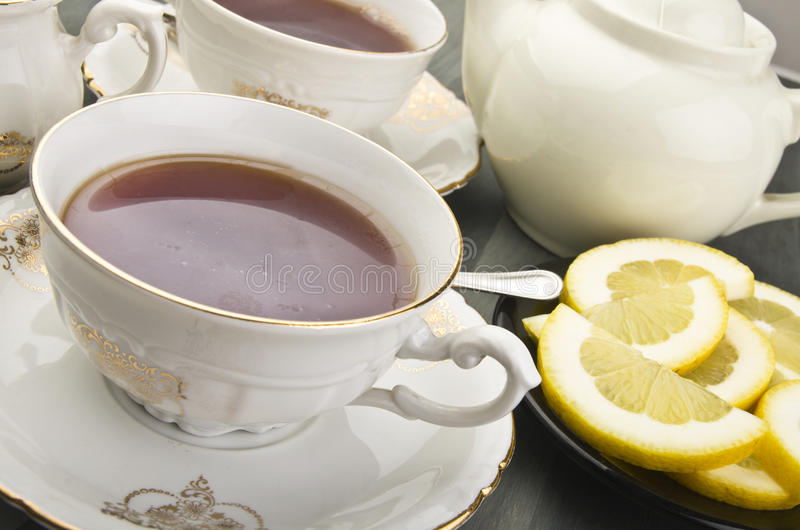 Cup of lemon tea stock images
