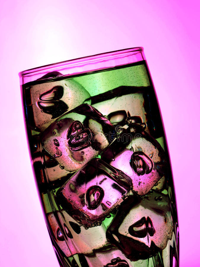 A cup of lemonade with ice cubes stock images