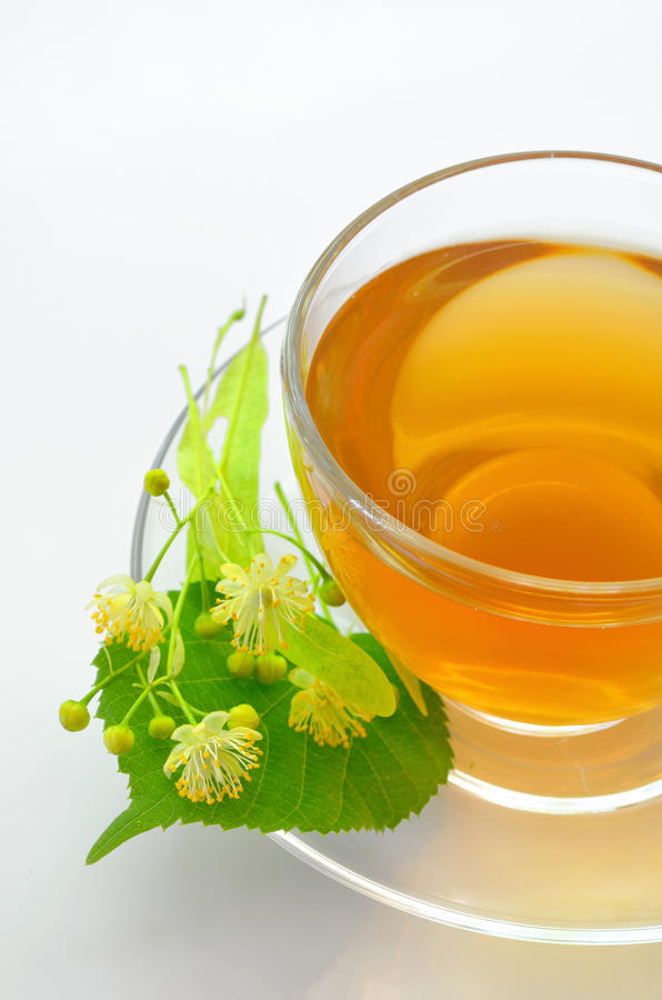 Cup with linden tea and flowers royalty free stock image