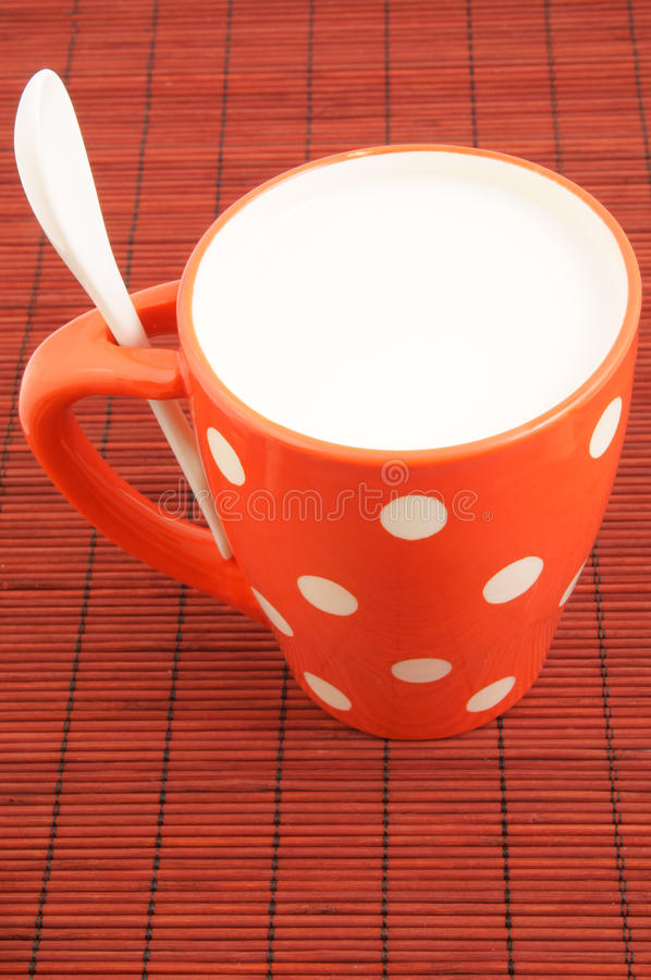 Download Cup of milk on placemat stock image. Image of polka, ceramic - 24636291