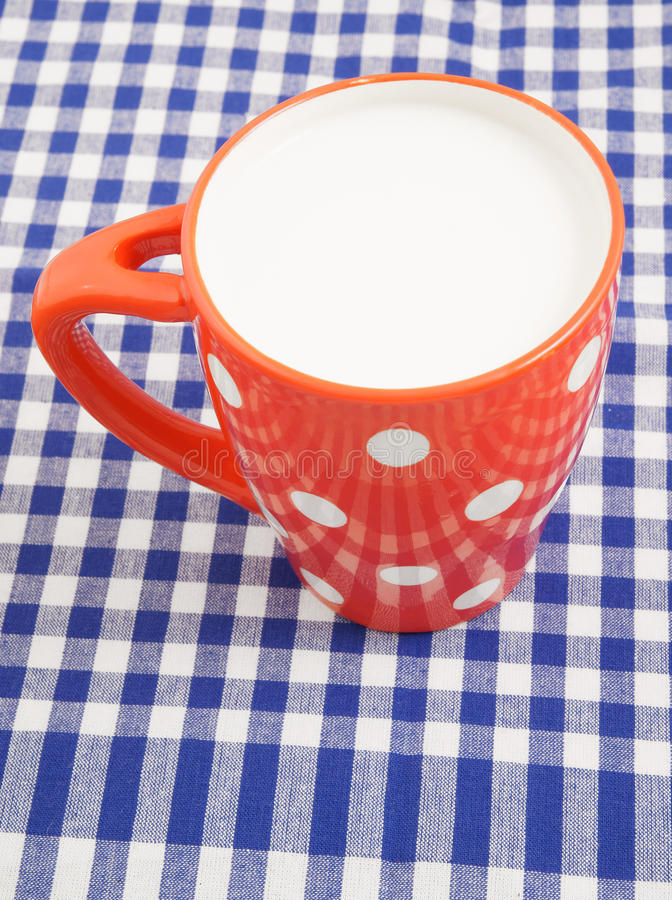 Download Cup of milk on tablecloth stock image. Image of blue - 24636213
