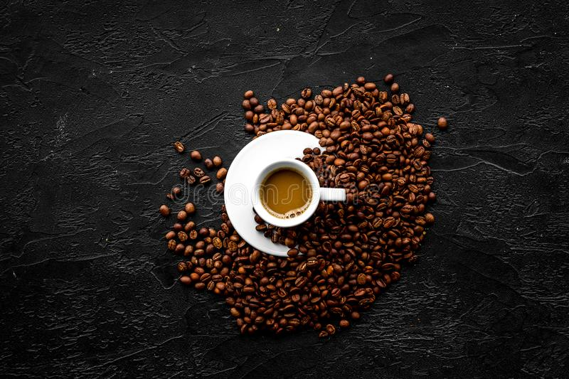 Cup of milky coffee on black table top view copyspace. Coffee background. royalty free stock photography