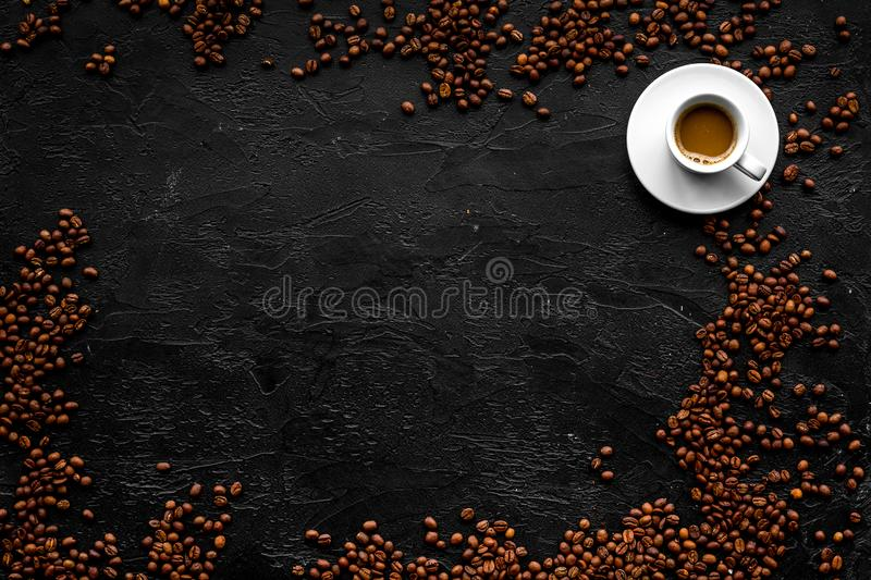 Cup of milky coffee on black table top view copyspace. Coffee background. royalty free stock photos