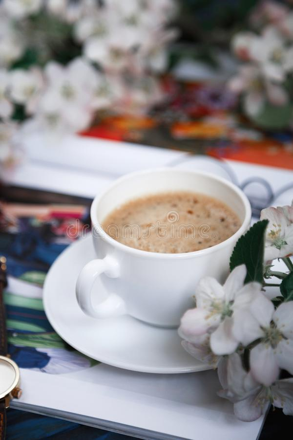 Cup of morning coffee with flowers stock images