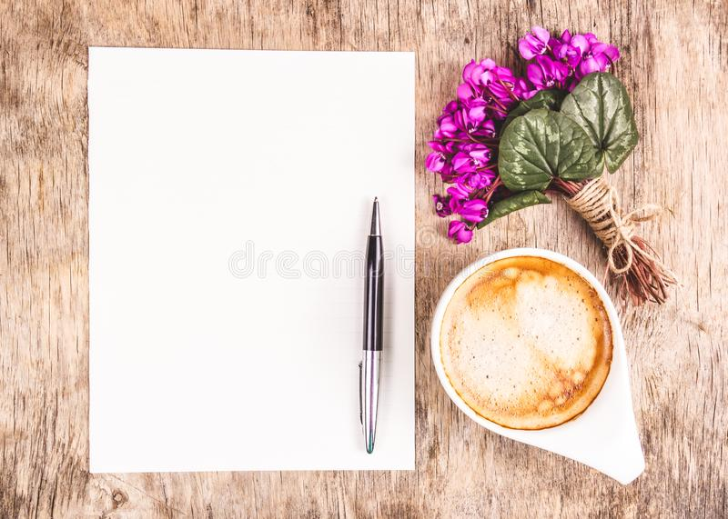 Cup of morning coffee, letter and flowers. Romantic concept. royalty free stock images