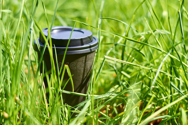 A cup of morning coffee standing in the grass stock images