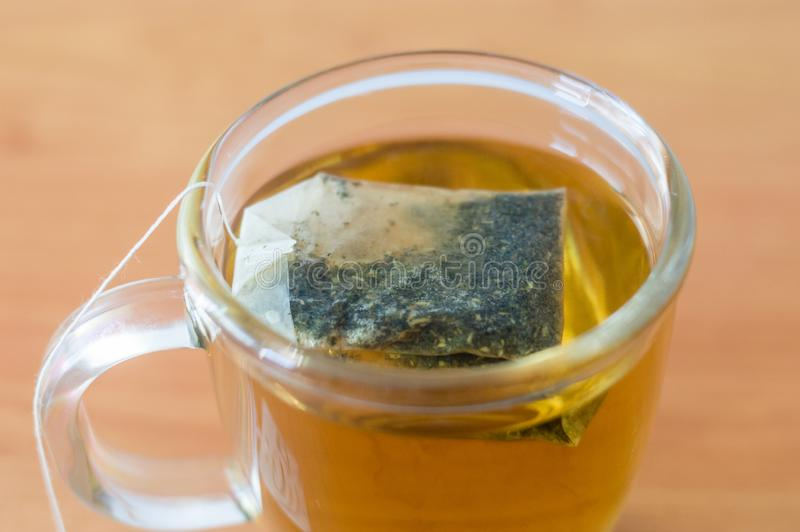 A cup of nettle tea with bag.  royalty free stock images