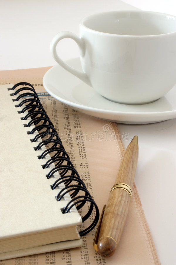 Cup and notebook royalty free stock photography
