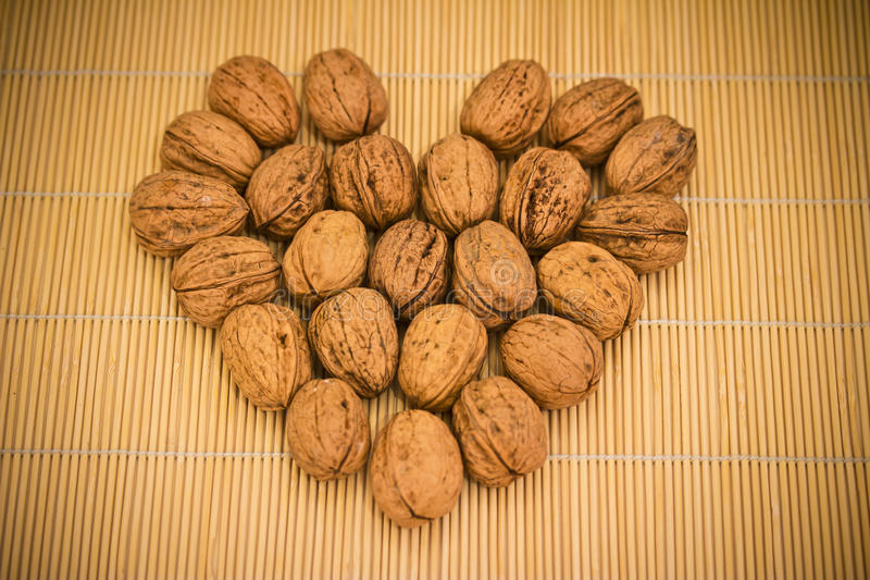 Download Cup Of Nuts On Bamboo Table Cloth Stock Photo - Image: 28503060