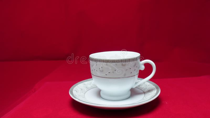 A small, bowl-shaped container for drinking from, typically having a handle. royalty free stock images