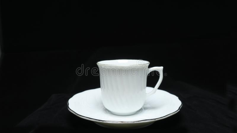 A small, bowl-shaped container for drinking from, typically having a handle. royalty free stock image