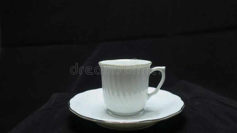 A small, bowl-shaped container for drinking from, typically having a handle. royalty free stock photography