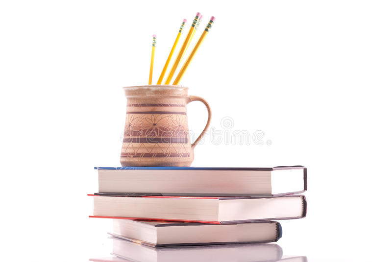 Cup of Pencils. On Pile of College Text Books stock image