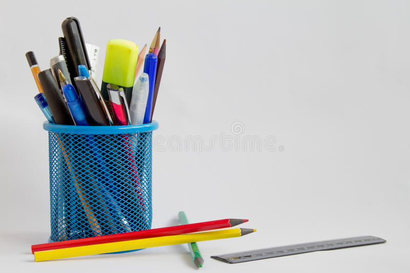 Cup with pens and pencils. On a white background stock photo