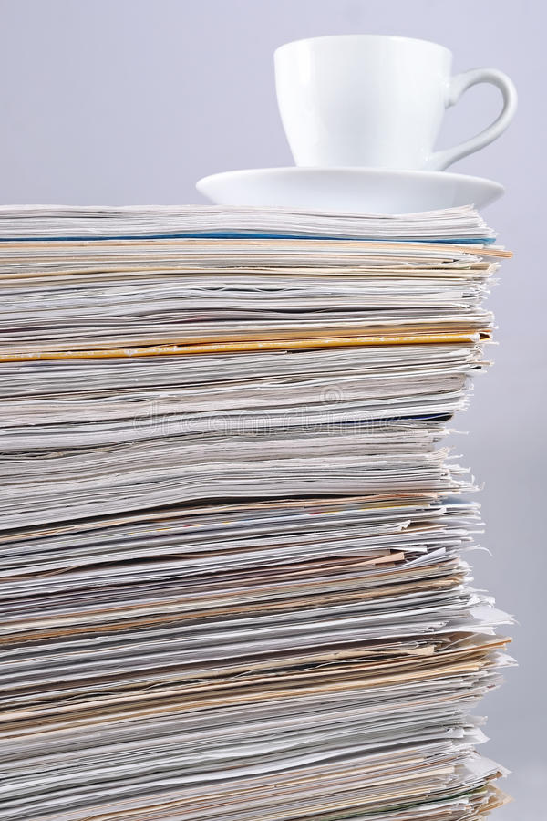 Cup On A Pile Of Papers Stock Photo