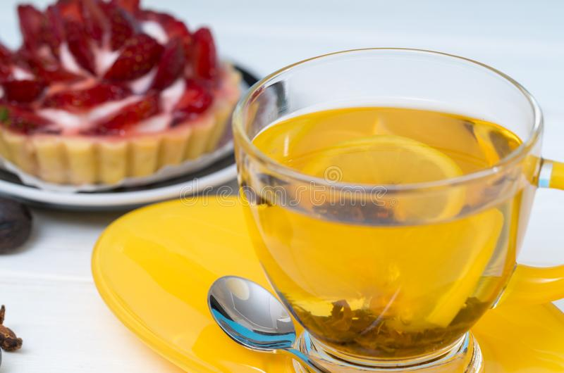 Cup of relaxing hot spicy lemon tea royalty free stock photo