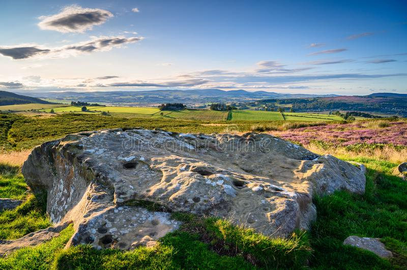 Cup and Ring Rock Art at Lordenshaws Hillfort. Lordenshaws Hillfort is located near Rothbury in Northumberland National Park and has several large stones with royalty free stock photography